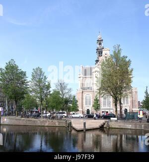17th century Westerkerk, Protestant church, Amsterdam Jordaan district, Keizersgracht canal, Netherlands. Homo monument - Stock Photo