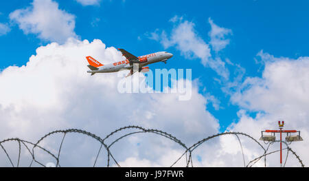 Nantes, FRANCE - April 27, 2017 ; Airbus A320-214 of EasyJet registered HB-JXC flying above Nantes Atlantique Airport - Stock Photo