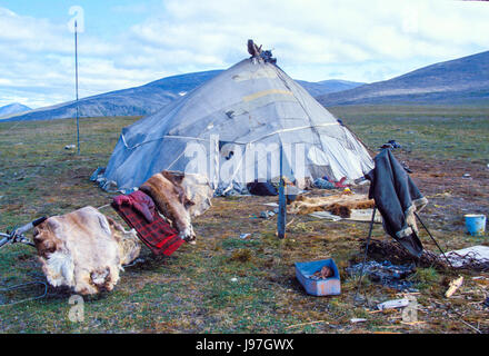 Nomadic Chukchi reindeer herders' yurt encampment on the Chukchi or Chukotka Peninsula, in the Russian Far East. - Stock Photo