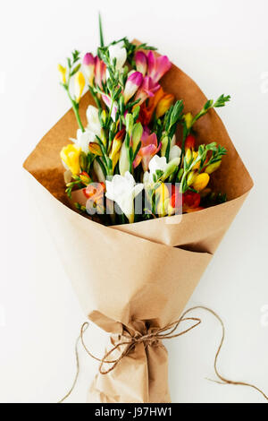 Bouquet yellow flowers wrapped in blue striped paper on blue stock bouquet wrapped in paper stock photo mightylinksfo Gallery