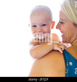Mother holding baby boy (18-23 months) - Stock Photo