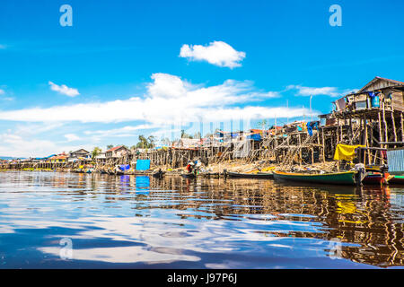 A stretch of wooden village houses in the remote Heart Of Borneo. Villagers built their wooden houses on stilts - Stock Photo