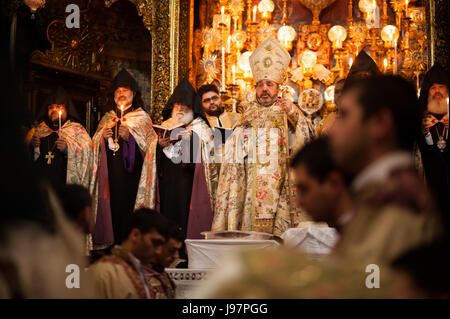 Armenian Patriarch of Jerusalem, Nourhan Manougian, leads a special Maundy Thursday mass in the Cathedral of St. - Stock Photo