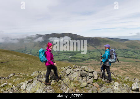 Chatting on White Pike with the Mountain of Blencathra as a Backdrop, Lake District, Cumbria, UK. - Stock Photo
