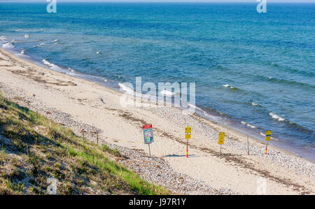 Havang nature reserve, Sweden - May 18, 2017: Environmental documentary. Warning signs at the public beach telling - Stock Photo
