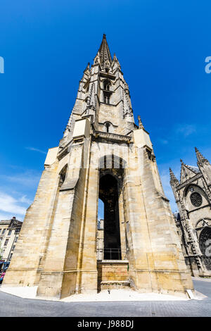 Iconic spire of St Michael's Basilica, a Gothic architecture church in Bordeaux, in the wine-growing region, a port - Stock Photo
