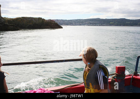 Little girl enjoying a boating trip from Howth Harbour to Ireland's Eye in Dublin Ireland dublin bay howth pier - Stock Photo