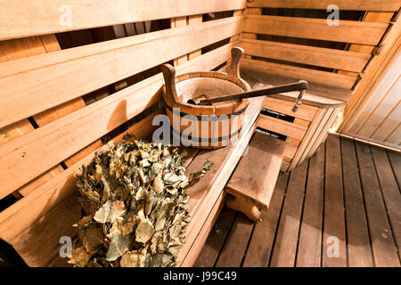 Empty wooden sauna room with ladle, bucket ready to be used - Stock Photo