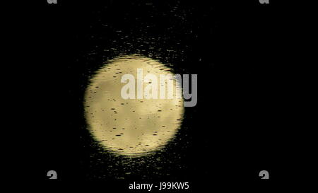 Full Moon reflected in the Salton Sea salty water in Southern California - Stock Photo