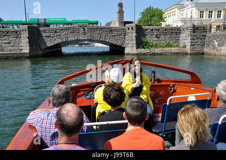 Boat trip on the Ostra Hamnkanalen Malmo, Sweden with tour guide speaking into a microphone and bus crossing the - Stock Photo