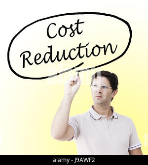 Young man with professional look is drawing a circle around the words 'Cost Reduction', on a transparent surface - Stock Photo