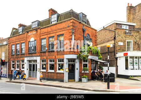 Customers drinking outside the historic Angel Inn in Highgate Village, London, UK - Stock Photo