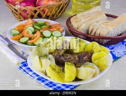 fried hen with a potato and lettuce on a dish - Stock Photo