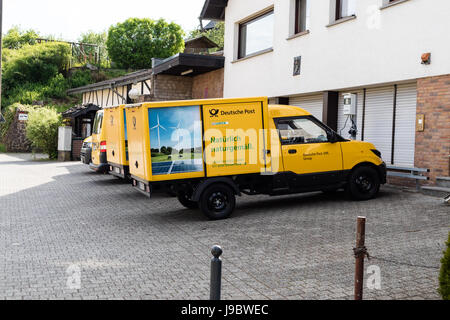 Two 'Streetscooter' - electric car with square box from Deutsche Post DHL - Nettersheim, North Rhine Westphalia, - Stock Photo