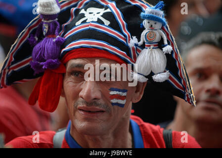 A Costa Rica fan cries in San José's Plaza de la Democracía after the Costa national team's loss to the Netherlands - Stock Photo