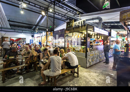 HO CHI MINH CITY, VIETNAM - APRIL 10, 2017: People have dinner in the covered Ben Thanh street food market in Ho - Stock Photo