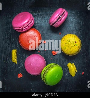 Colorful macaroons. Sweet macarons on dark background .Top view. - Stock Photo