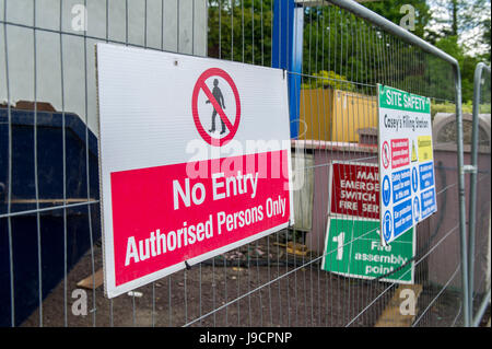 No Entry and warning signs on a metal fence on a building site. - Stock Photo