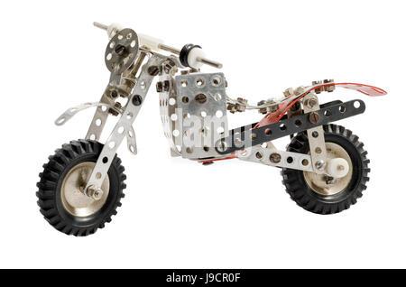 Toy old vintage motorbike isolated on white background - Stock Photo