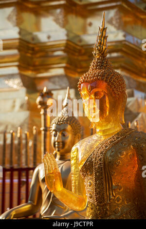 beautiful light on a gold statue in Thailand - Stock Photo