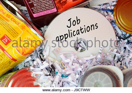 Job applications, data disc thrown in Bin, Dorset, England. - Stock Photo