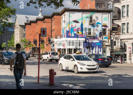 Montreal, Canada - 31 May 2017: Graffiti street art murals along Avenue des Pins - Stock Photo