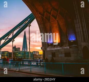 Tower Bridge, view through the gate on The Shard, at sunset, Southwark, London, England, United Kingdom - Stock Photo