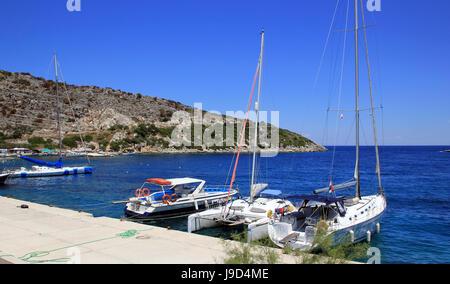 Yachts in Agios Nikolaos port on Zakynthos island, Greece - Stock Photo