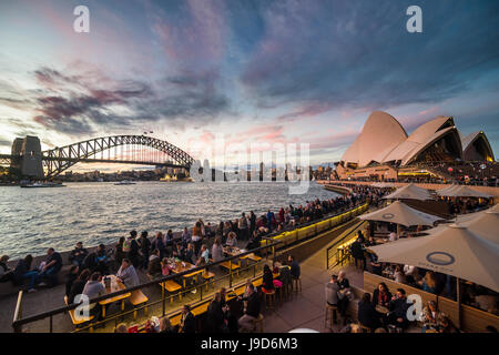 Sydney Harbour with the Harbour Bridge and Opera House after sunset, Sydney, New South Wales, Australia, Pacific - Stock Photo