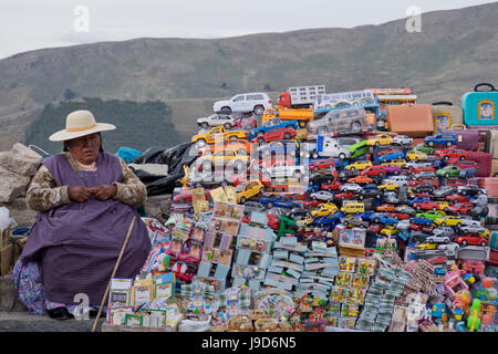 Traditional miniature cars and money for sale at a stall in the resort of Copacabana on Lake Titicaca, Bolivia, - Stock Photo