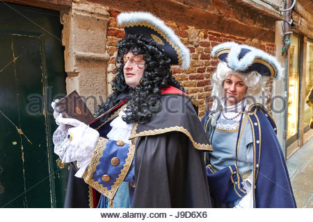 Masks at the Venice Carnival in St. Mark's Square, Venice, Veneto, Italy, Europe - Stock Photo
