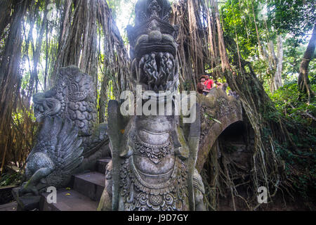 Very beautiful carved bridge with overgrowing trees, Sacred Monkey Forest Sanctuary, Ubud, Bali, Indonesia, Southeast - Stock Photo