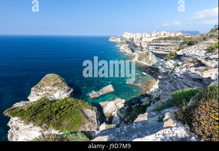 Turquoise sea frames the medieval old town and fortress perched on top of cliffs, Bonifacio, Corsica, France, Mediterranean - Stock Photo