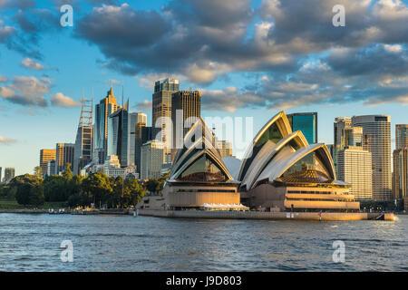 The Sydney Opera House, UNESCO World Heritage Site, and skyline of Sydney at sunset, New South Wales, Australia, - Stock Photo