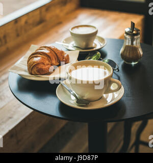 Coffee latte, cappuccino and croissant on table , square crop - Stock Photo