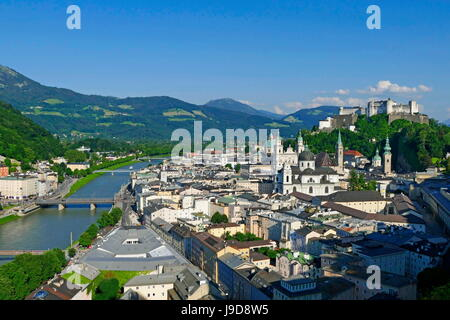 View from Moenchsberg Hill across Salzach River with Cathedral, Collegiate Church and Fortress Hohensalzburg, Salzburg, - Stock Photo