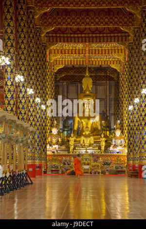 Buddhist Monk in Wat Suan Dok in Chiang Mai Thailand - Stock Photo