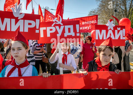 Participants in the May Day procession of the Communist Party on the International Workers' Solidarity Day along - Stock Photo