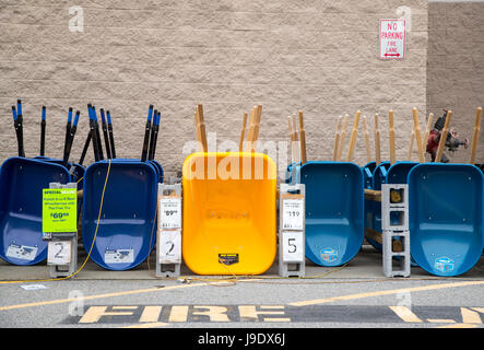 Wheelbarrows at a Lowe's home improvement store in Monroe, New York - Stock Photo