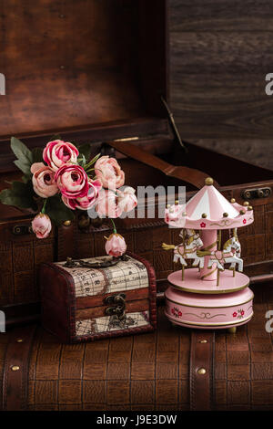 Wooden carousel horses with old vintage look on marble background - Stock Photo