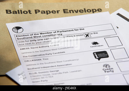 Postal ballot paper with envelope for local Southend West candidates on a coffee table in natural light - Stock Photo
