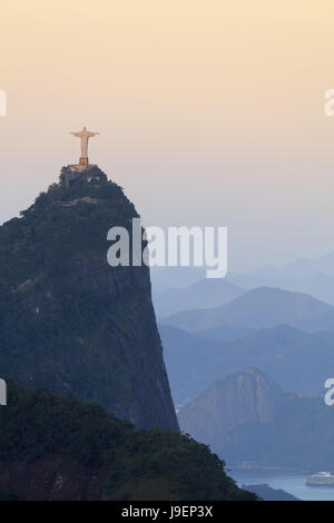 Christ on Corcovado in Tijuca national park in Rio de Janeiro - the Unesco World Heritage-listed Carioca Landscapes - Stock Photo