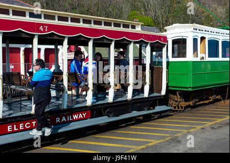 Asian tourists board a Manx Electric Railway tram at Douglas, Isle of Man - Stock Photo