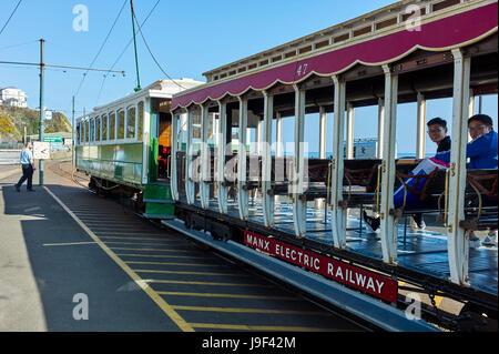 Asian tourists aboard a Manx Electric Railway tram at Douglas, Isle of Man - Stock Photo