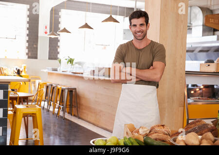 Portrait Of Male Owner Of Organic Food Store - Stock Photo