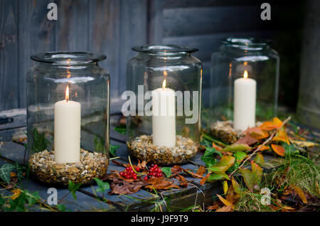 Candles in jars - Stock Photo