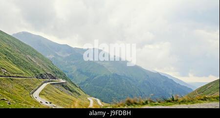 Fagaras mountains, Carpathians with green grass and rocks, Transfagarasan road - Stock Photo