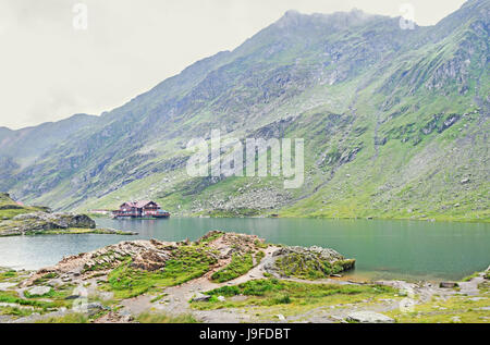 Balea Lake glacier lake situated at 2034m altitude in the Fagaras Mountains, Sibiu County. - Stock Photo