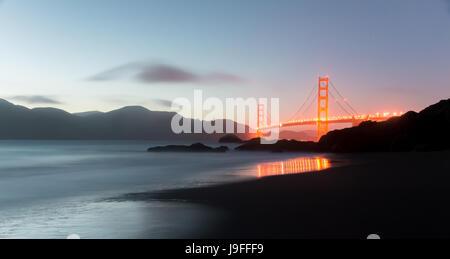 Golden Gate Bridge and Marin Hills Panorama at Dusk. - Stock Photo