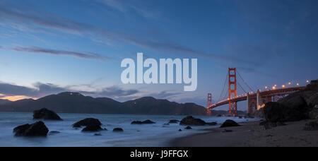 Golden Gate Bridge and Marin Hills Panorama at Dusk. Marshall's Beach, San Francisco, California, USA. - Stock Photo